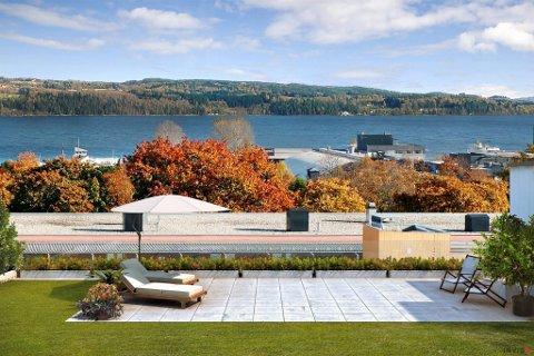 FELLES TAKTERRASSE: Arkitektene har prøvd å framstille hvordan utsikten blir fra en av de felles takterrassene. Illustrasjon: Inviso AS