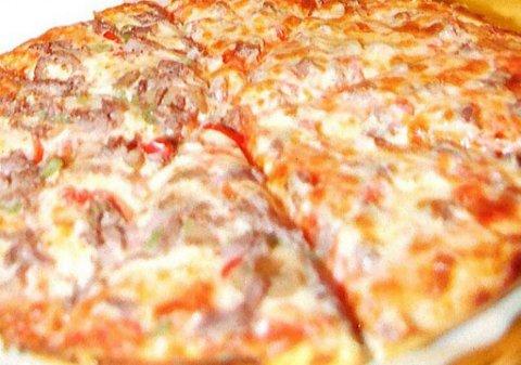 SOVNET: 25-åringen satte pizzaen direkte på den varme kokeplata og sovnet. Han ble reddet av naboer. ILLUSTRASJONSFOTO: ANB