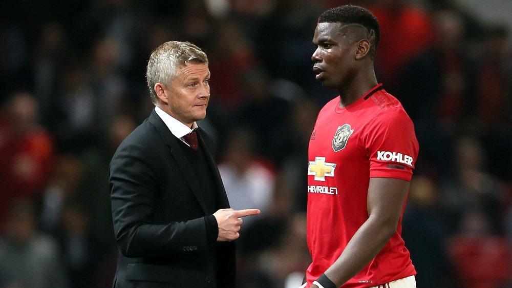 Klikk på bildet for å forstørre. GRYENDE KONFLIKT: Paul Pogba og agent Mino Raiolas oppførsel skaper stadig støy for Manchester United og Ole Gunnar Solskjær.
