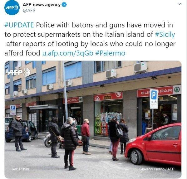 Klikk på bildet for å forstørre. POLITI VOKTER: På dette bildet ser man en politimann som vokter inngangen til supermarkedet.