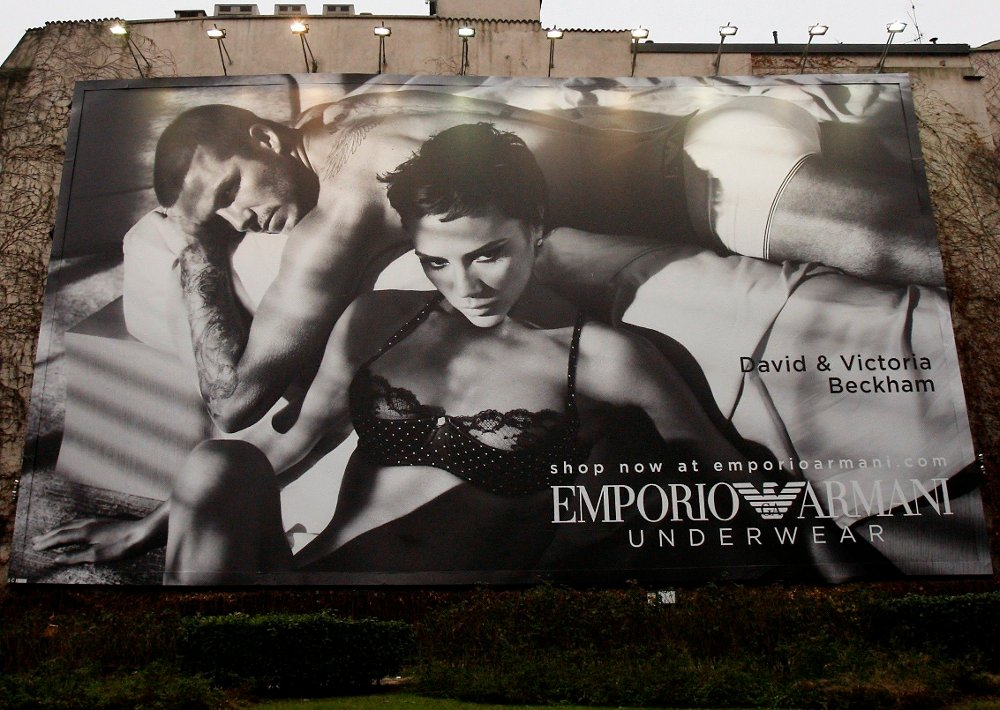 Klikk på bildet for å forstørre. Fashion icon Victoria Beckham appears with her husband David as the official worldwide testimonial for Emporio Armani women's underwear in a billboard in downtown Milan, Italy, Wednesday, Jan. 21, 2009. The advertising campaign for Armani's underwear featuring Victoria Beckham will cover fashion and lifestyle magazines and billboards in major cities around the world.