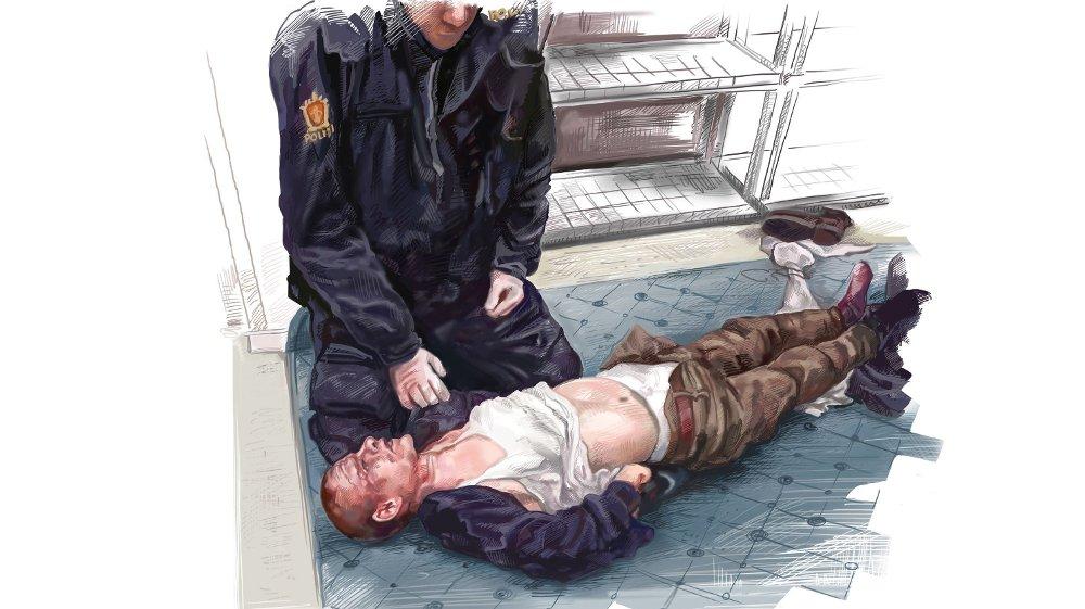 Klikk på bildet for å forstørre. Dette til nå ukjente bildet viser terroristen i håndjern i det to politibetjenter har kontroll på ham. Han er full i blod i ansiktet etter basketaket med to av moskeens medlemmer. Politiet rer opp klærne hans for å sjekke ham for våpen.