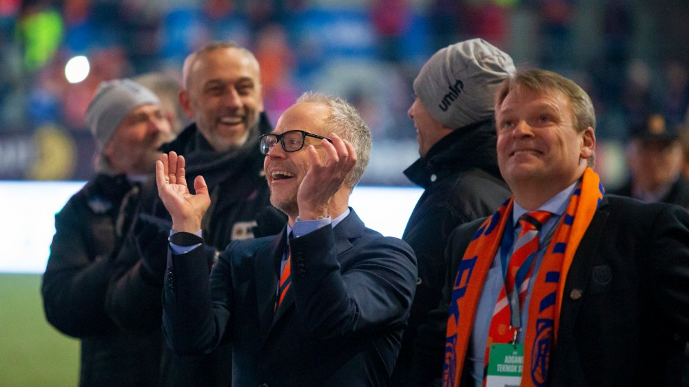 Click on the image to enlarge.  Ålesund 20191109. 1st division football 2019: Aalesund - Sandefjord.  Aalesund's director Geir S. Vik watches the fireworks after the first division match in football between Aalesund and Sandefjord at Color Line Stadium.  Board chairman Jan Petter Hagen on the right and coach Lars Bohinen on the left.