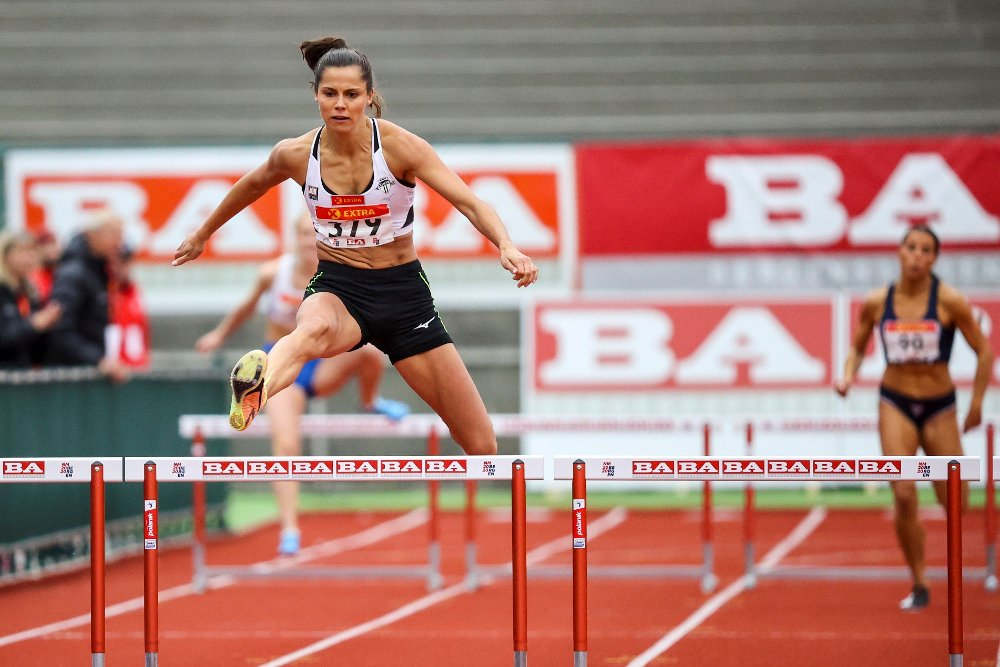 Click on the image to enlarge. THE KING'S CUP RACE: Amalie Hammild Iuel in action in the 400 meter hurdles during the NM in athletics at Fana Stadium.