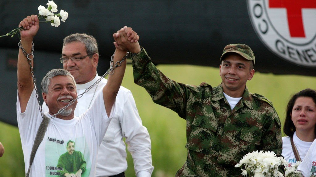 Pablo Emilio Moncayo is greeted by his father Gustavo Moncayo