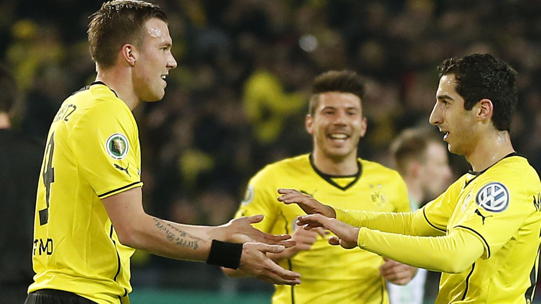 ANMELDT: Kevin Grosskreutz (t.v) påstås å ha kastet en kebab på en supporter. Her sammen med Dortmunds Henrikh Mkhitaryan og Milos Jojic.