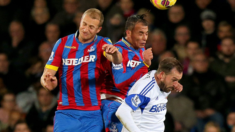 Crystal Palace's Brede Hangeland (left) and Marouane Chamakh (centre) battle with Sunderland's Steven Fletcher