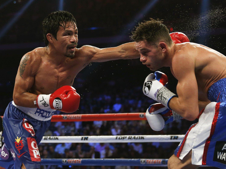 SUVEREN: Manny Pacquiao (til venstre) fikk lett match mot ubeseirede Chris Algieri i Macau.