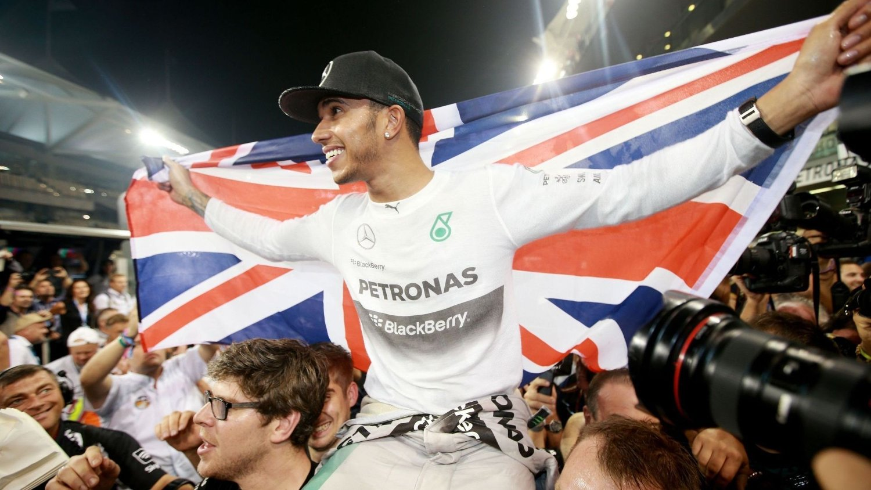 Mercedes Lewis Hamilton celebrates becoming World Champion after victory in the 2014 Abu Dhabi Grand Prix at the Yas Marina Circuit, Abu Dhabi, United Arab Emirates.