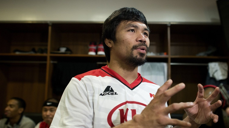 FULL KONTROLL? Manny Pacquiao stresser ikke med at en skade på basketballbanen kan koste ham dyrt. FOTO: NTB scanpix