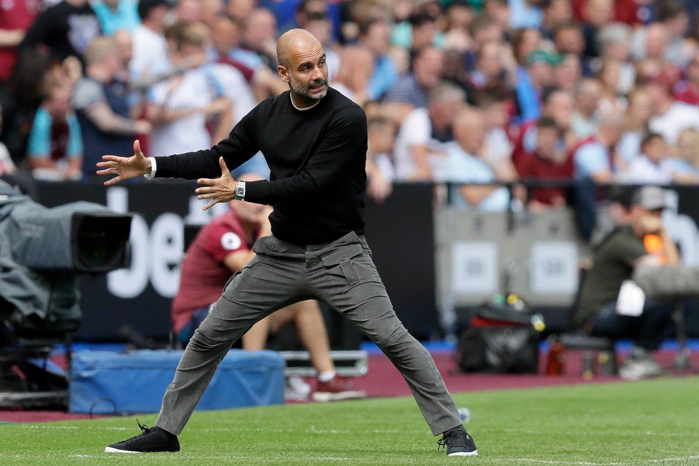 Manchester City-manager Pep Guardiola har grunn til å være fornøyd etter at FIFA lot klubben slippe med en beskjeden bot for brudd på reglene som strengt begrenser adgangen til å signere mindreårige spillere fra andre land. Foto: Kirsty Wigglesworth, AP / NTB scanpix