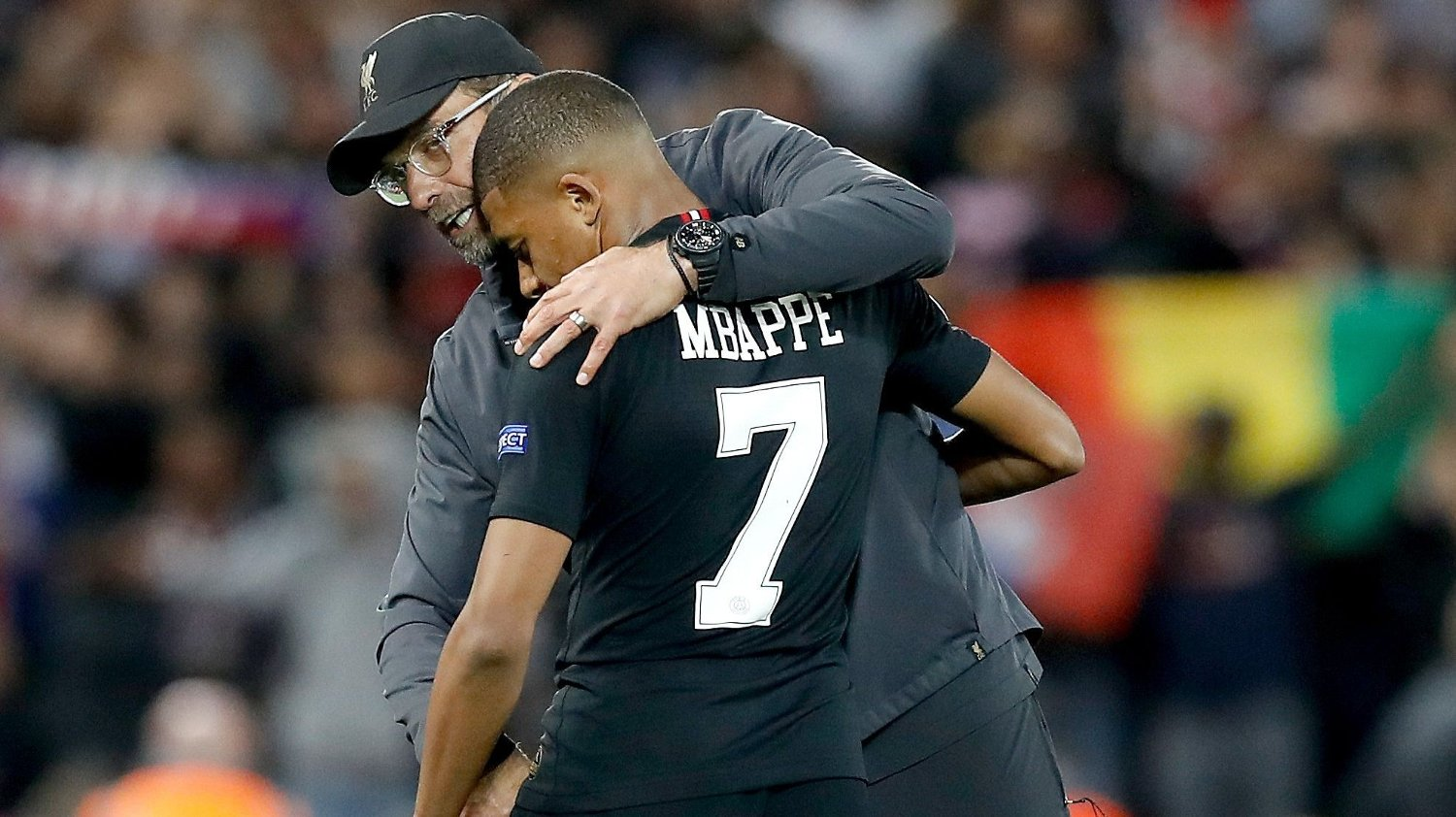 Liverpool manager Jurgen Klopp with Paris Saint-Germain's Kylian Mbappe after the final whistle