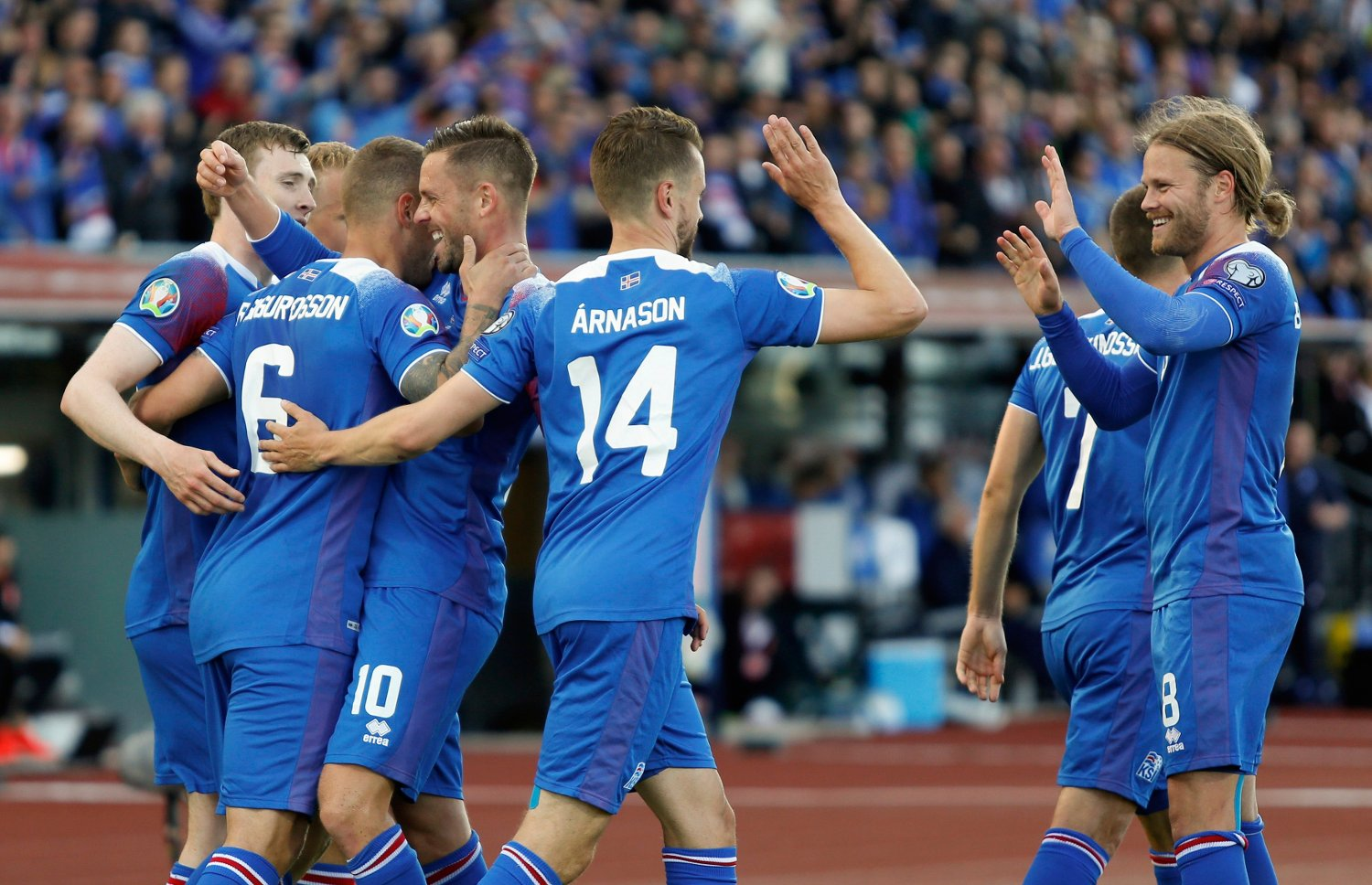The Icelandic team celebrates Ragnar Sigurdsson's second goal against Turkey, during the Euro 2020 group H qualifying soccer match between Iceland and the Turkey at Laugardalsvollur stadium in Reykjavik, Iceland, Tuesday June 11, 2019.
