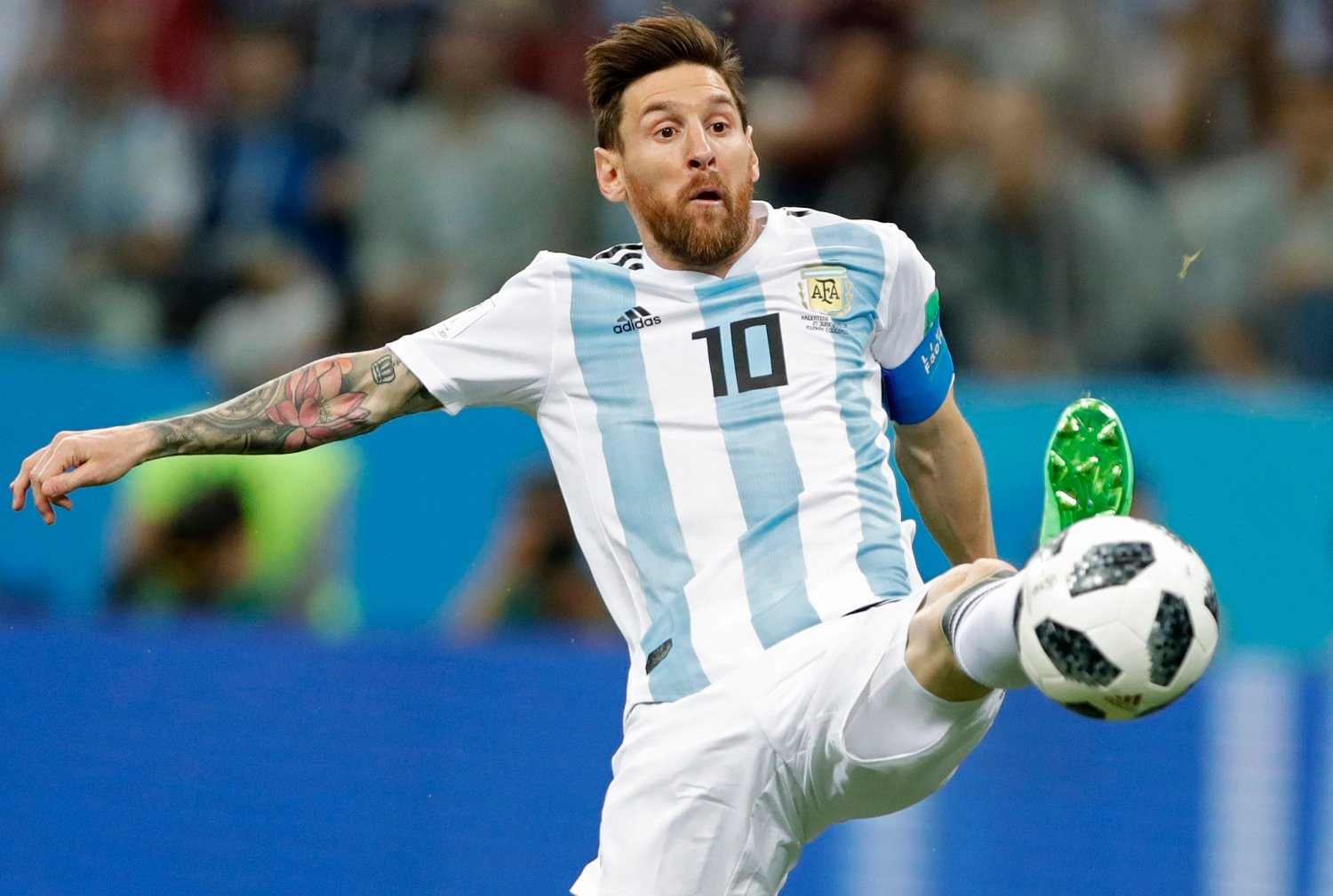 FILE - In this June 21, 2018 file photo Argentina's Lionel Messi reaches for the ball during the group D match between Argentina and Croatia at the 2018 soccer World Cup in Nizhny Novgorod Stadium in Nizhny Novgorod, Russia. Five-time winner Lionel Messi along with Cristiano Ronaldo and Virgil van Dijk are the three finalists for the FIFA best player award.