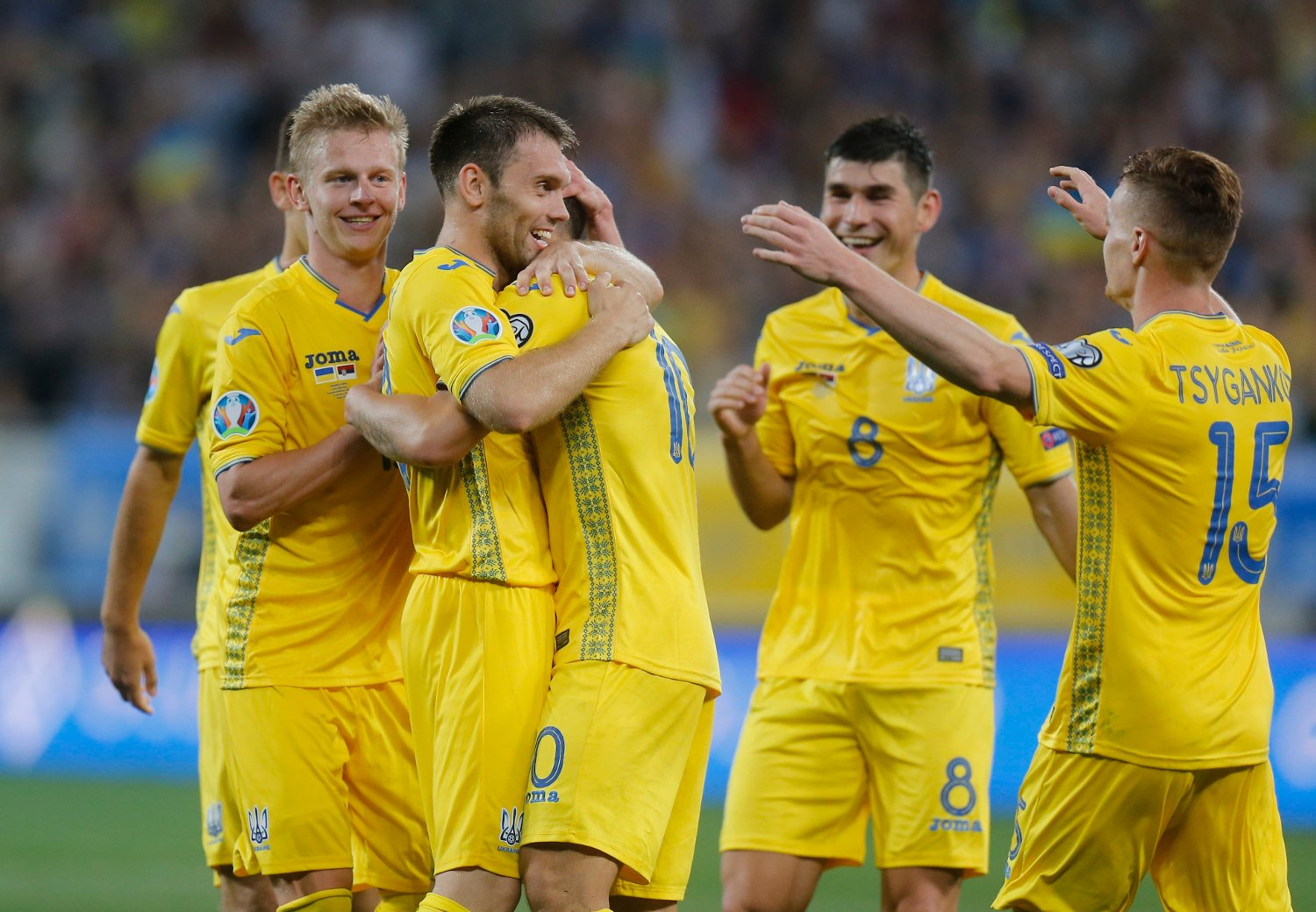 Ukraine's players celebrate after scoring their side's third goal during the Euro 2020 group B qualifying soccer match between Ukraine and Serbia at the Arena Lviv stadium in Lviv, Ukraine, Friday, June. 7, 2019.