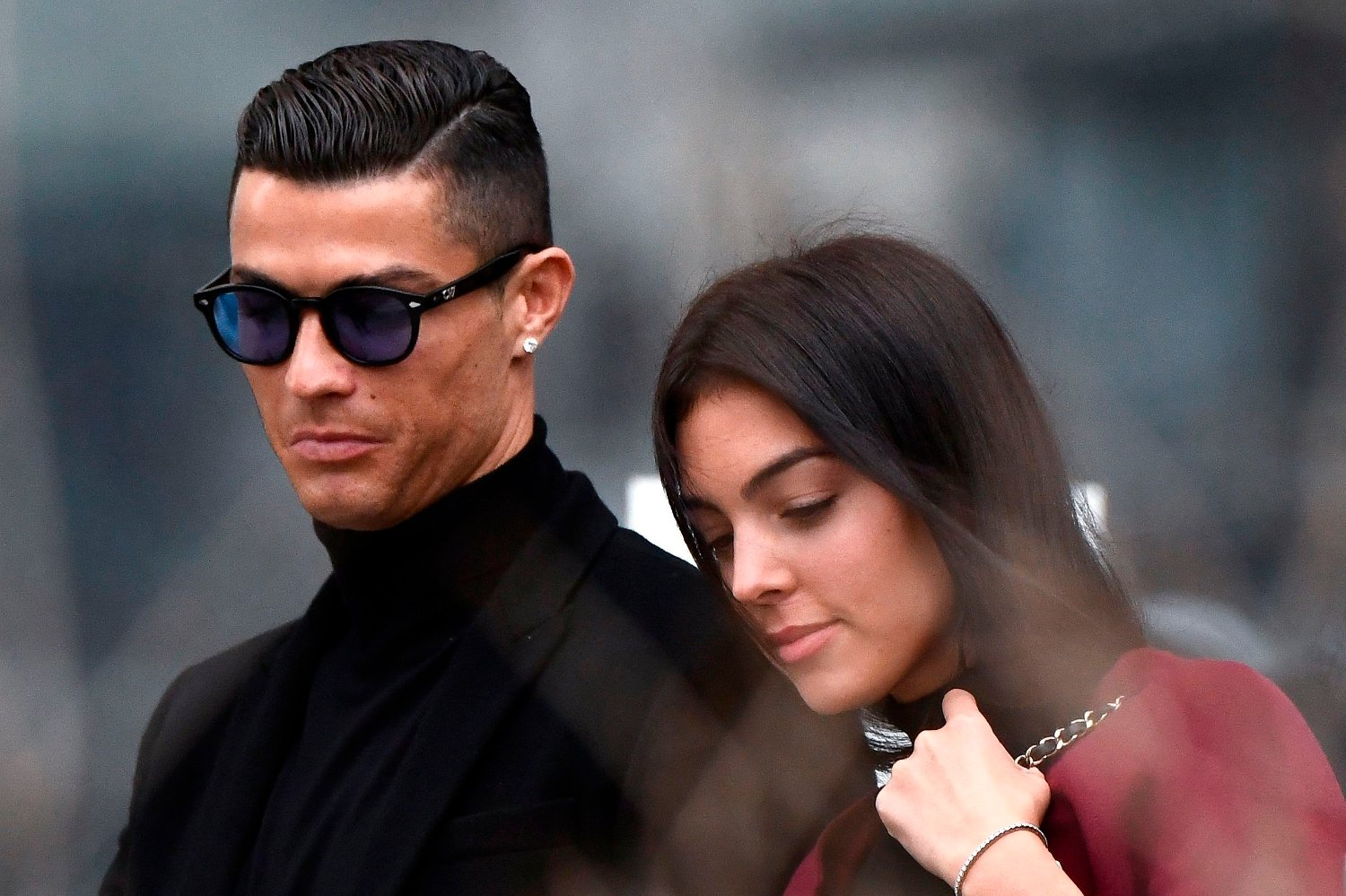 uventus' forward and former Real Madrid player Cristiano Ronaldo leaves with his Spanish girlfriend Georgina Rodriguez after attending a court hearing for tax evasion in Madrid on January 22, 2019. - Ronaldo is expected to be given a hefty fine after Spanish tax authorities and the player's advisors made a deal to settle claims he hid income generated from image rights when he played for Real Madrid.