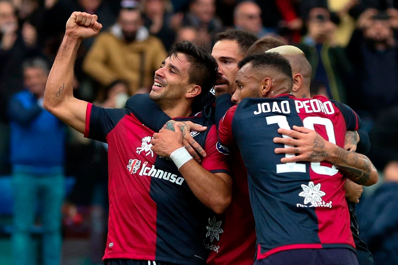 Cagliari's Giovanni Simeone, left, celebrates with teammates after scoring during a Serie A soccer match between Cagliari and Fiorentina at the Sardegna Arena stadium in Cagliari, Italy, Sunday, Nov. 10, 2019.