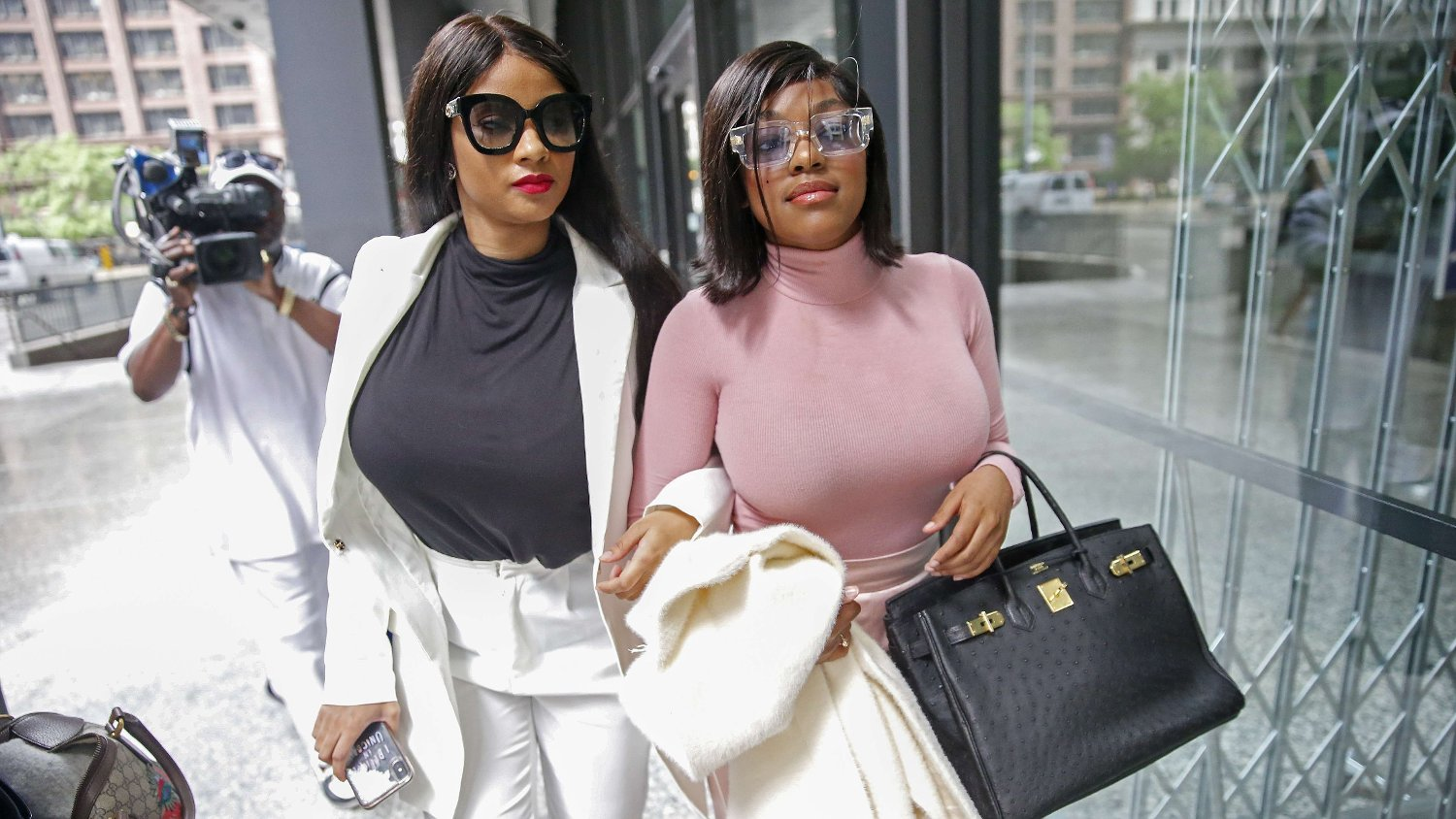 Bond Hearing Held In Chicago For R. Kelly's Federal Criminal Cases CHICAGO, ILLINOIS - JULY 16: Supporters of singer R. Kelly, Azriel Clary and Joycelyn Savage, leave after the singer's arraignment at the Dirksen Federal Building on July 16, 2019 in Chicago, Illinois. Nuccio DiNuzzo/Getty Images/AFP == FOR NEWSPAPERS, INTERNET, TELCOS & TELEVISION USE ONLY ==