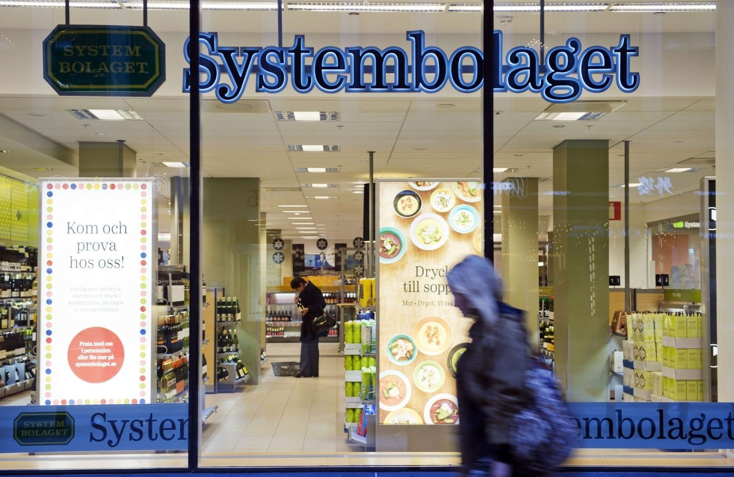 TO GO WITH AFP STORY BY ANNA-KARIN LAMPOU A woman walks outside one of the government controlled Systembolaget liquor stores in downtown Stockholm on December 19, 2013. Systembolaget is the only retail store allowed to sell alcoholic beverages that contain more than 3.5 percent alcohol. According to Systembolaget, it has a nationwide retail network of 422 stores and over 500 agents serving smaller communities. AFP PHOTO/JONATHAN NACKSTRAND