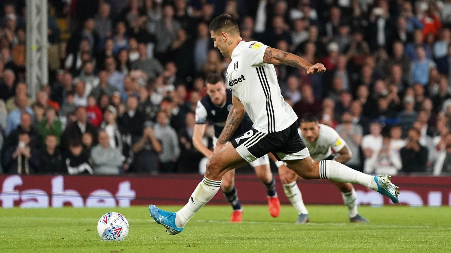 Fulham's Aleksandar Mitrovic scores a penalty for his side's third goal