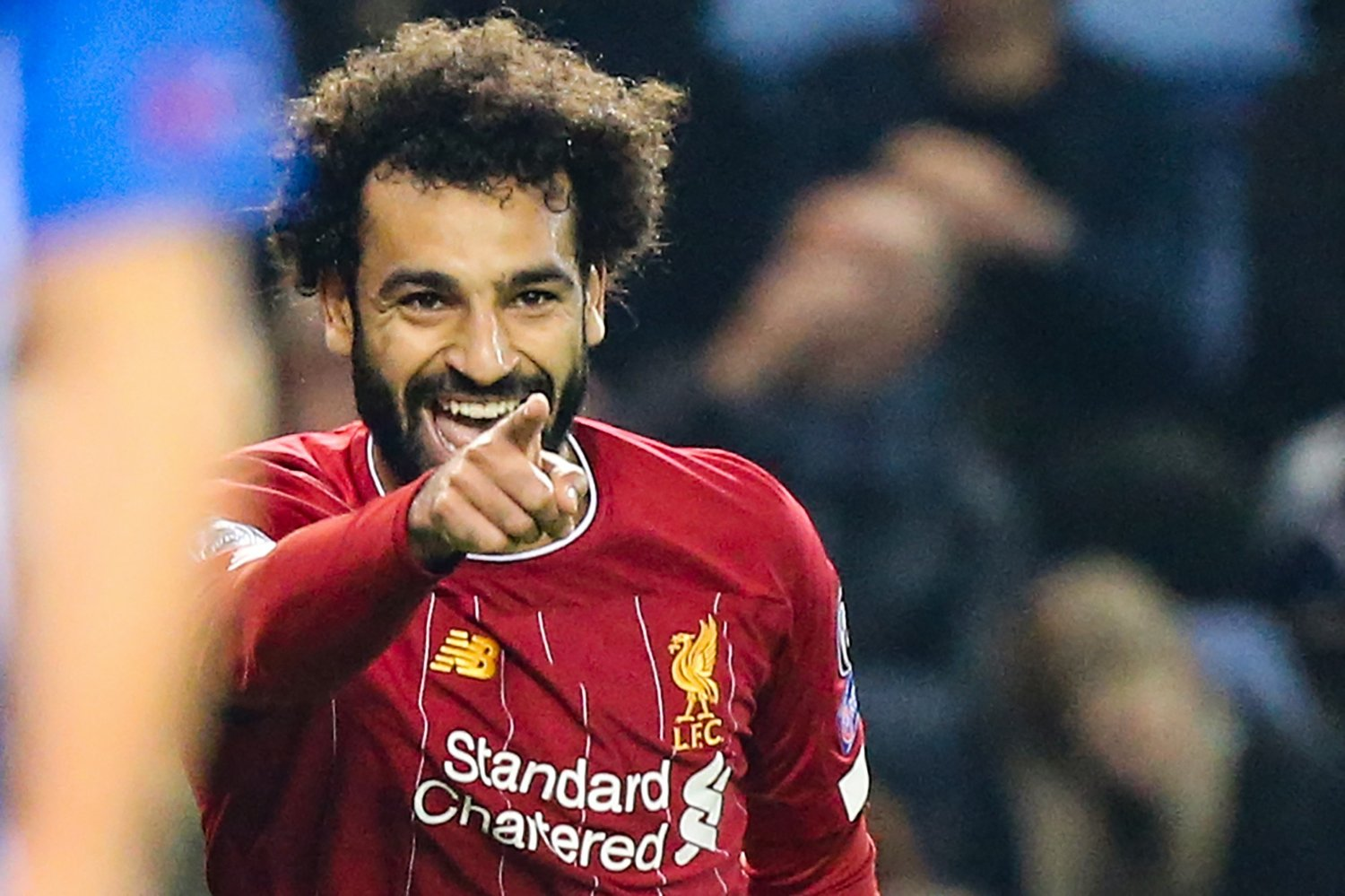 Liverpool's Egyptian midfielder Mohamed Salah celebrates after scoring a goal during the UEFA Champions League Group E football match between
