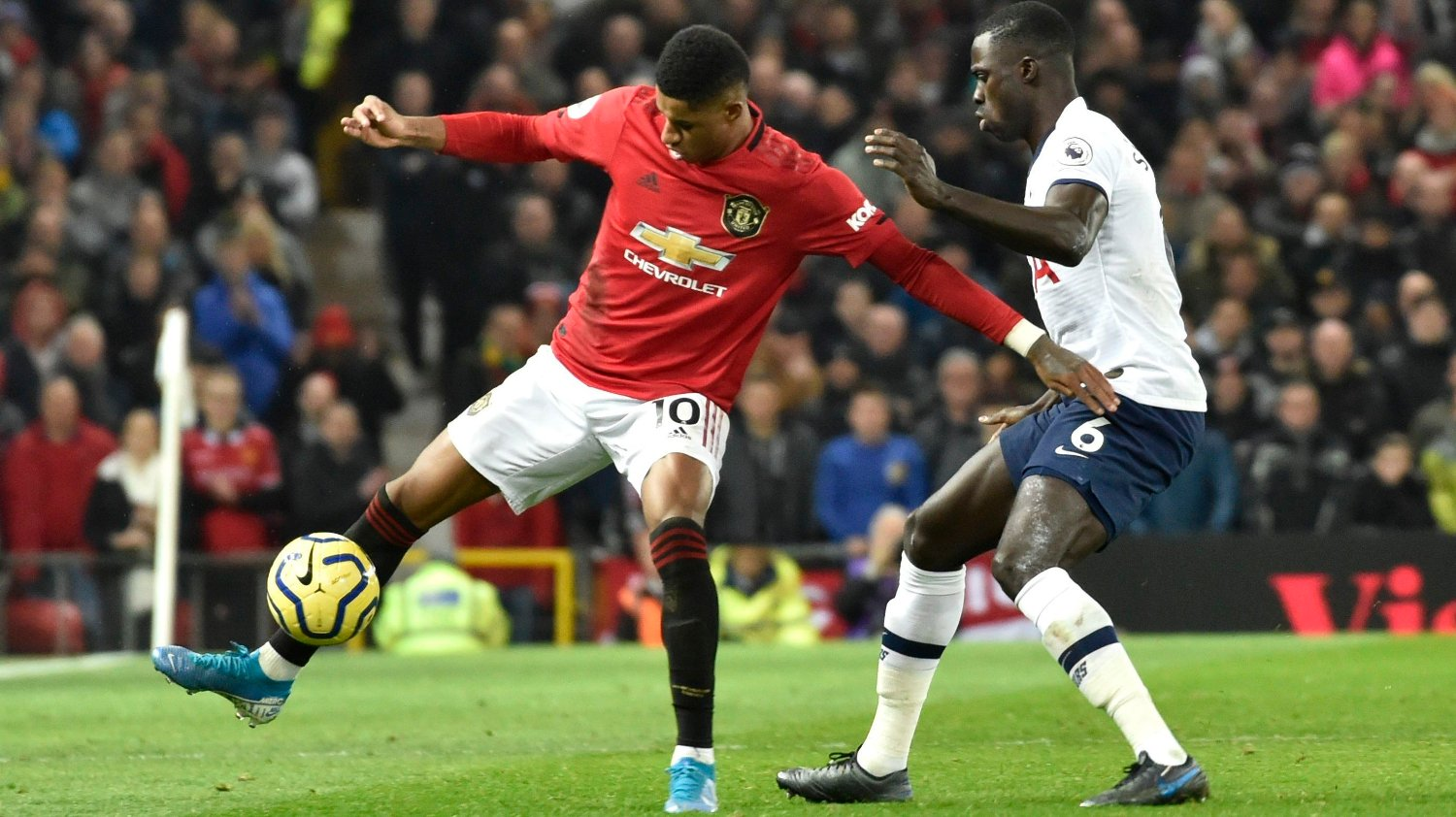 Manchester United's Marcus Rashford, left, and Tottenham's Davinson Sanchez challenge for the ball during the English Premier League soccer match between Manchester United and Tottenham Hotspur at Old Trafford in Manchester, England, Wednesday, Dec. 4, 2019.