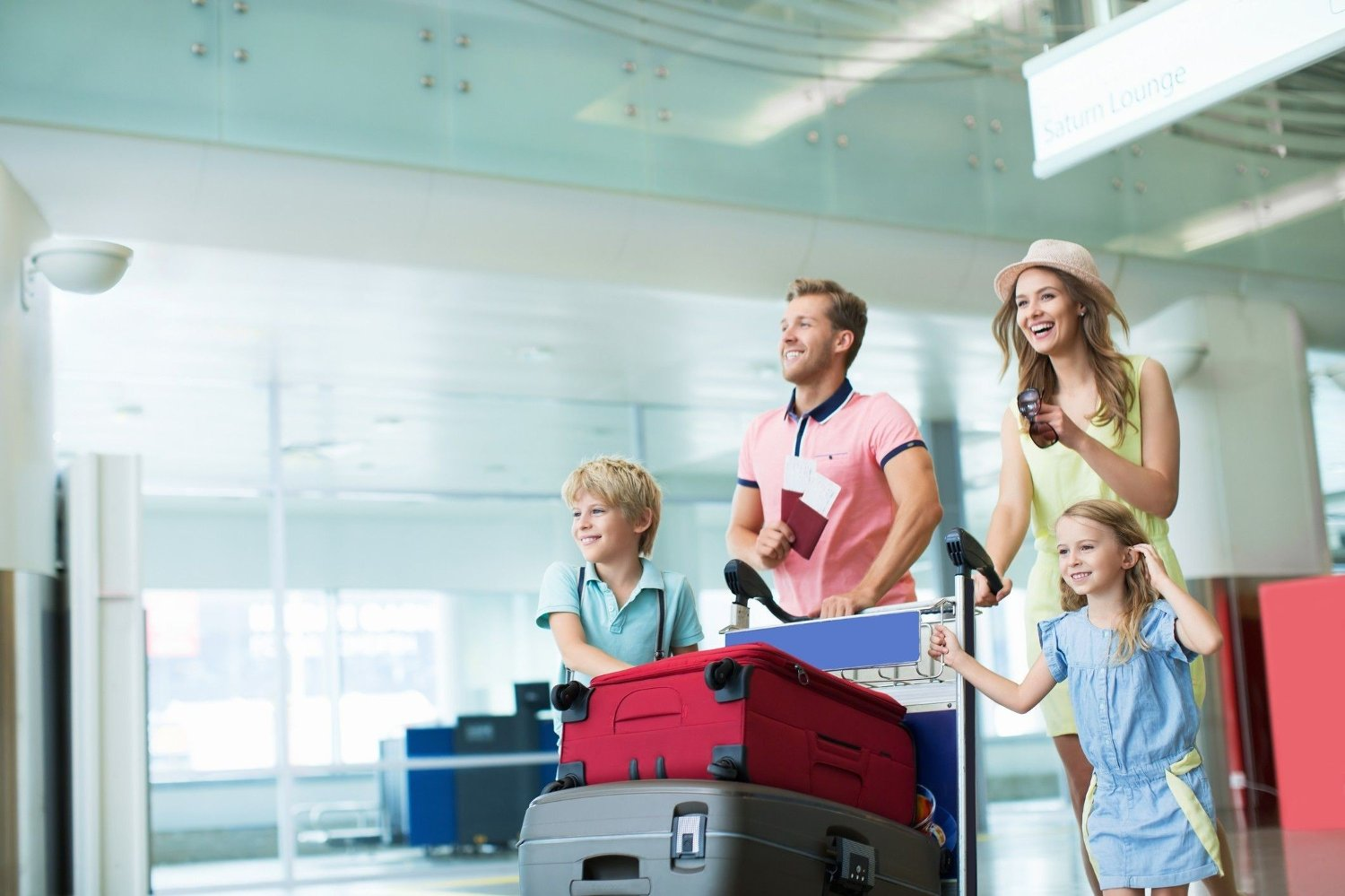 Travel Young family at the airport