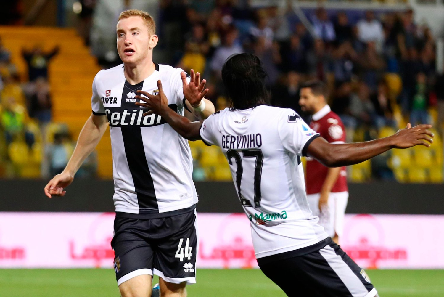 Parma's Dejan Kulusevski, left, jubilates with his teammate Gervinho after scoring a goal against Torino, during the Italian Serie A soccer match, Parma Calcio vs Torino FC at the Ennio Tardini stadium in Parma, Italy, Monday Sept. 30, 2019.