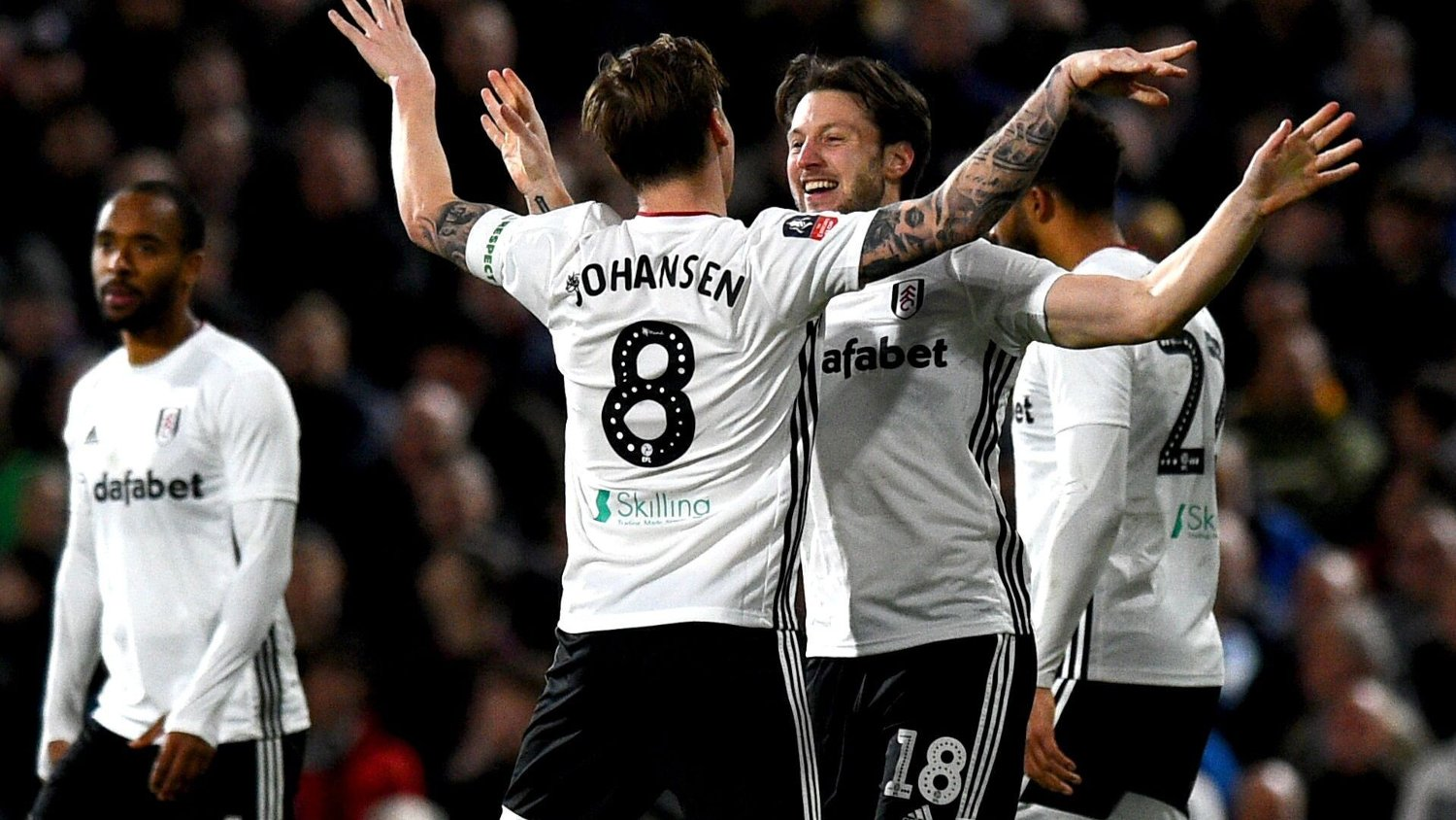 Fulham's Harry Arter celebrates scoring his side's second goal of the game with team mate Stefan Johansen during the FA Cup third round match at Craven Cottage, London.