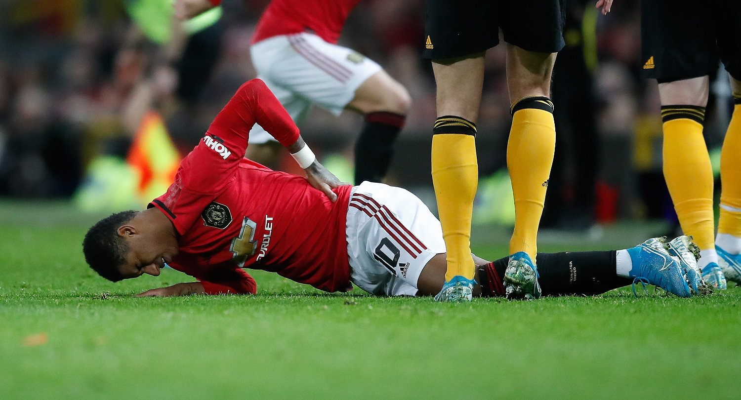 Manchester United's Marcus Rashford lies in pain after picking up a back injury during the FA Cup third round replay match at Old Trafford, Manchester.