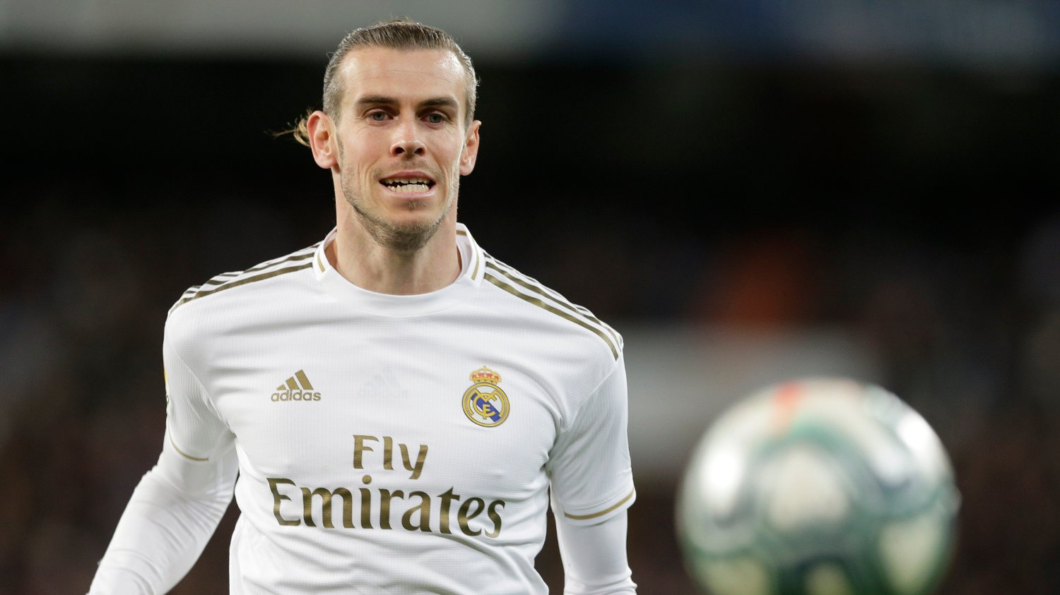 Real Madrid's Gareth Bale controls the ball during a Spanish La Liga soccer match between Real Madrid and Athletic Bilbao at the Santiago Bernabeu stadium in Madrid, Spain, Sunday Dec. 22, 2019.