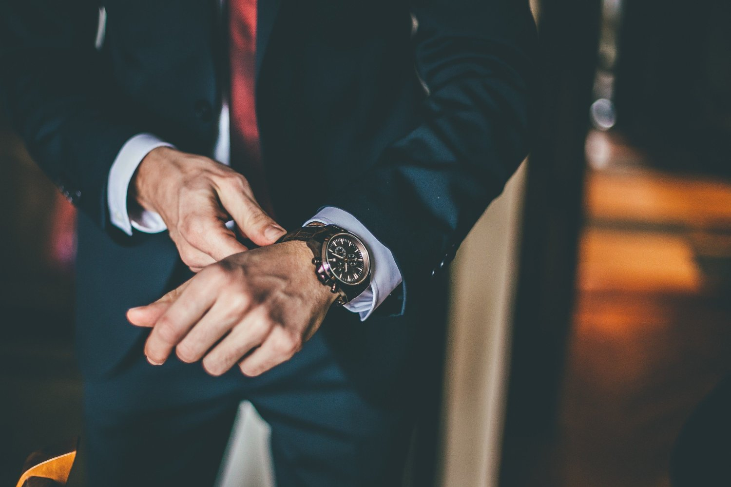 Well Dressed Man putting his wrist watch Well Dressed Man putting his wrist watch