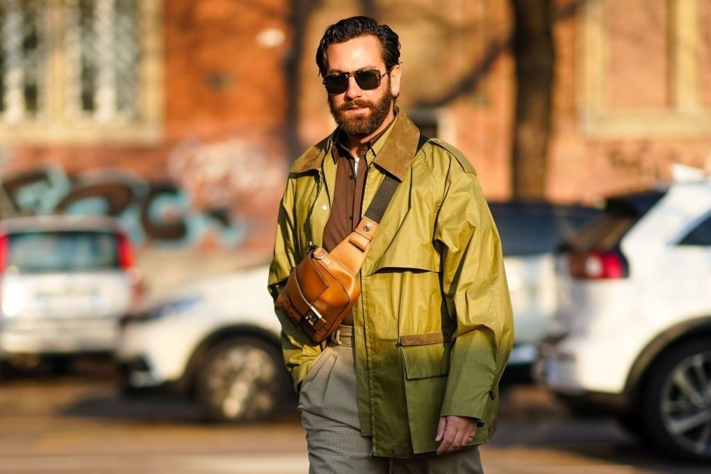 Street Style: January 13th - Milan Fashion Week Fall/Winter 2020/2021 MILAN, ITALY - JANUARY 13: Matthew Zorpas wears sunglasses, a brown leather fanny pack shoulder strapped Fendi bag, a green jacket, a brown shirt, shorts, outside Fendi, during Milan Fashion Week Menswear Fall/Winter 2020/2021, on January 13, 2020 in Milan, Italy.
