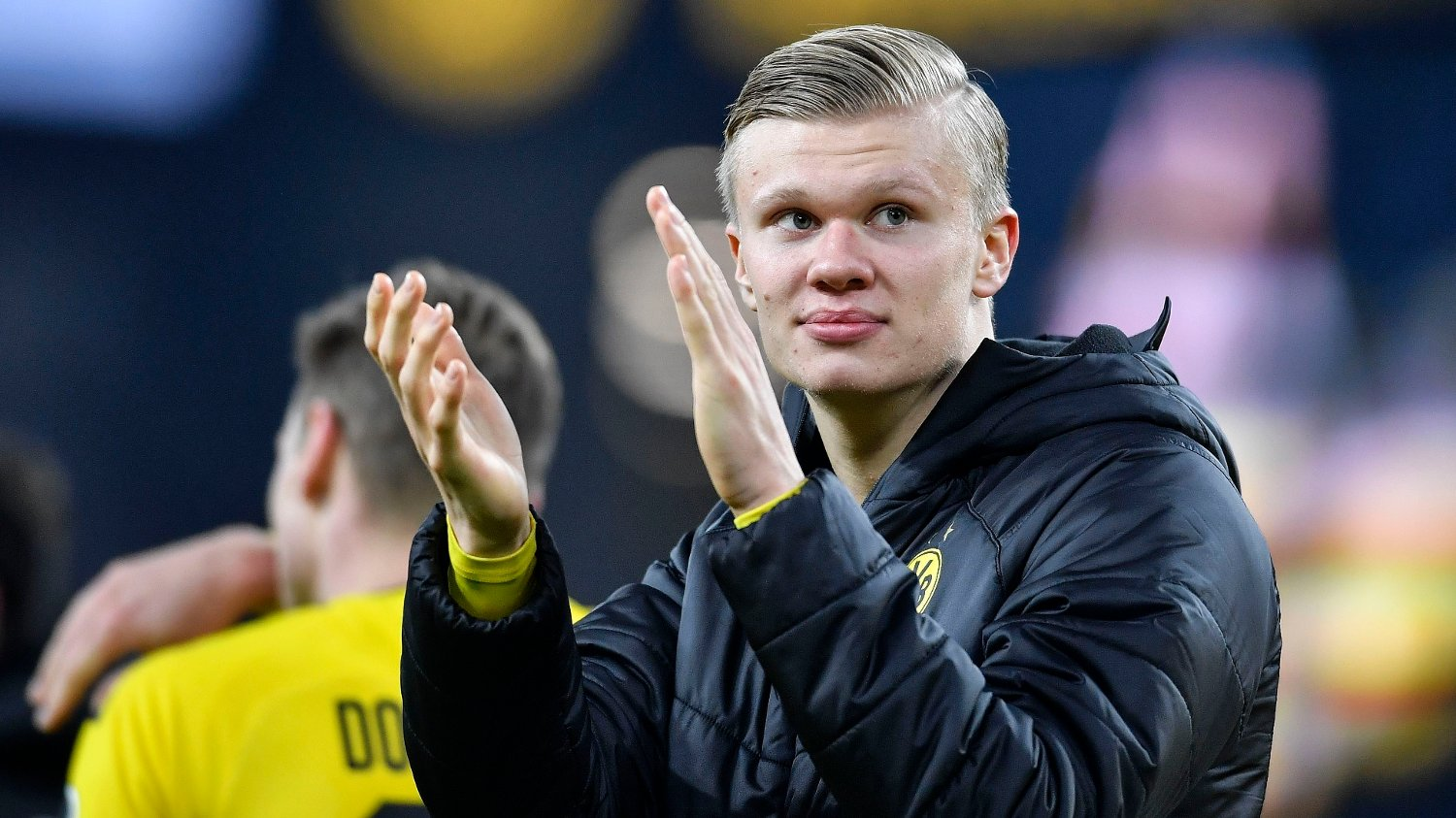 Dortmund's Erling Haaland claps hands to supporters after winning the German Bundesliga soccer match between Borussia Dortmund and Eintracht Frankfurt in Dortmund, Germany, Friday , Feb. 14, 2020.