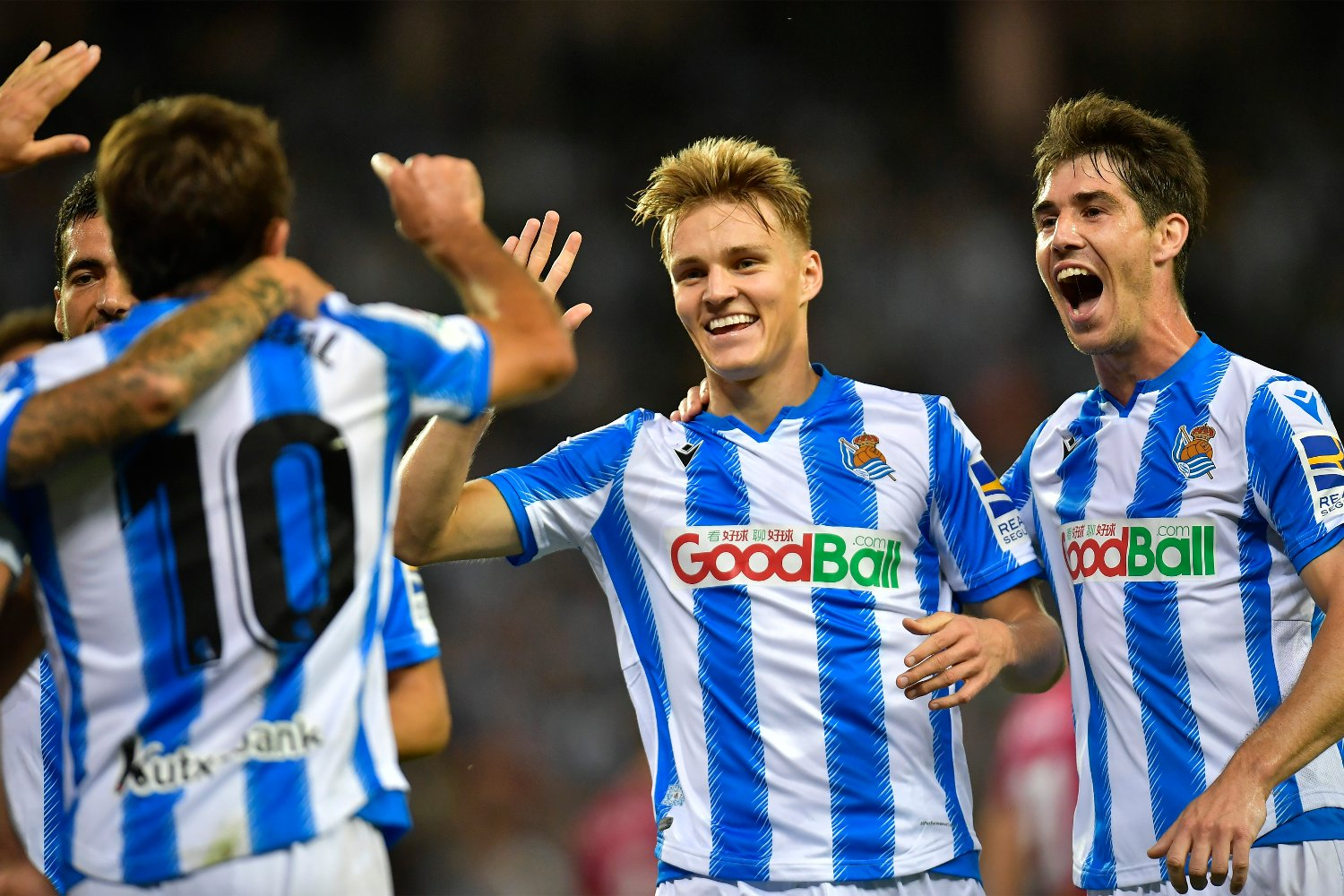 Real Sociedad's Martin Odegaard, center, celebrates after a goal of his team during the Spanish La Liga soccer match between Real Sociedad and Alaves at Reale Arena stadium, in San Sebastian, northern Spain, Thursday, Sept. 26, 2019.