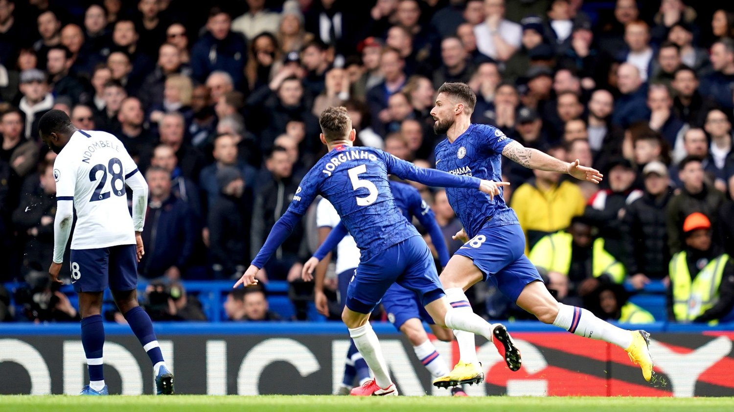 Chelsea's Olivier Giroud celebrates scoring his side's first goal of the game with team-mates during the Premier League match at Stamford Bridge, London.