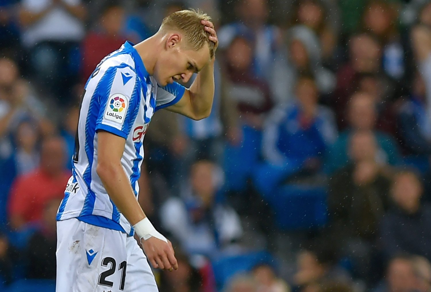 Real Sociedad's Norwegian midfielder Martin Odegaard gestures during the Spanish league football match between Real Sociedad and Getafe CF at the Anoeta stadium in San Sebastian on October 6, 2019.