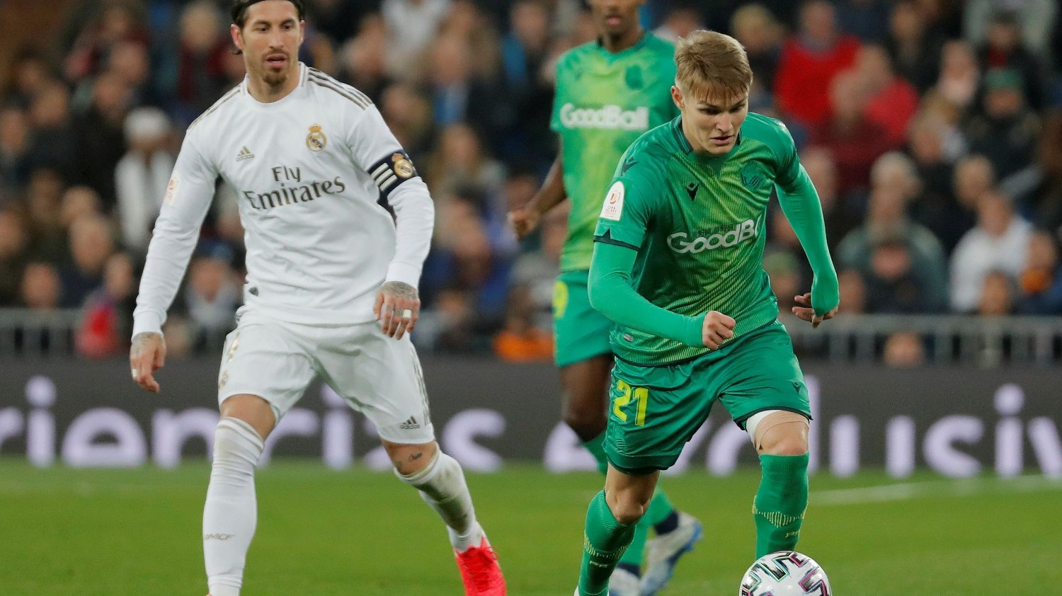 Soccer Football - Copa del Rey - Real Madrid v Real Sociedad - Santiago Bernabeu, Madrid, Spain - February 6, 2019 Real Sociedad's Martin Odegaard in action with Real Madrid's Sergio Ramos REUTERS/Susana Vera