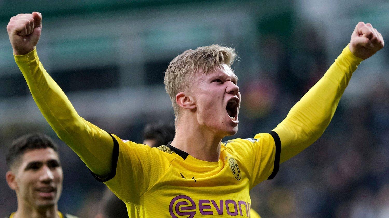 Dortmund's Erling Haaland celebrates scoring a goal against Werder Bremen during the German Bundesliga soccer match in Bremen, Germany, Saturday Feb. 22, 2020.