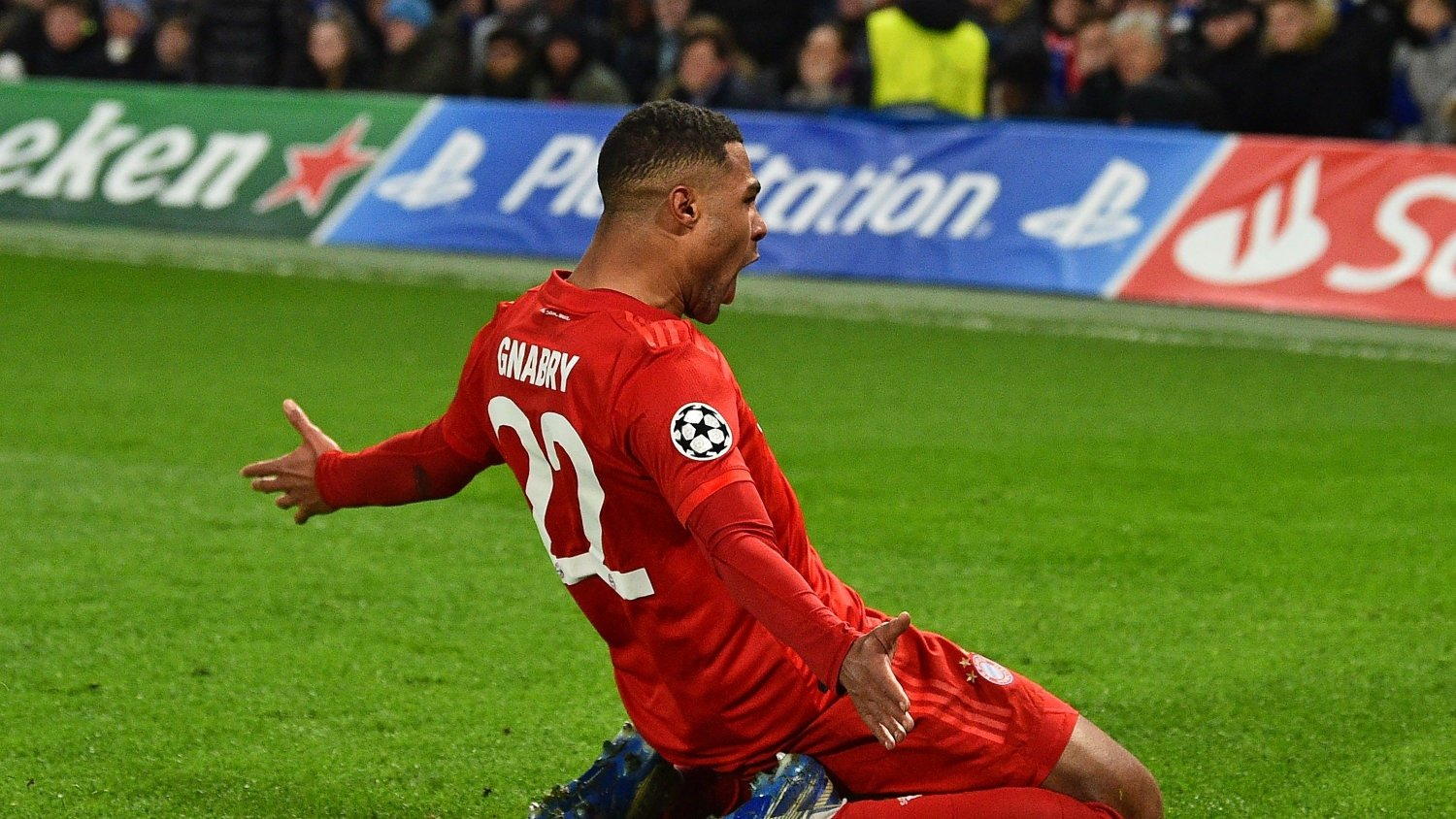 Bayern Munich's German striker Serge Gnabry celebrates after scoring their second goal during the UEFA Champion's League round of 16 first leg football match between Chelsea and Bayern Munich at Stamford Bridge in London on February 25, 2020.