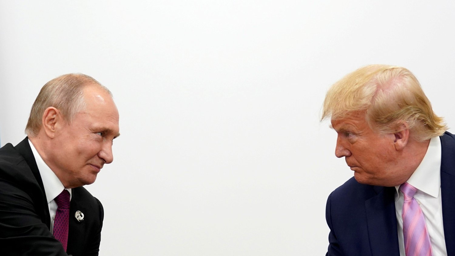 FILE PHOTO: U.S. President Donald Trump and Russian President Vladimir Putin hold a bilateral meeting at the G20 leaders summit in Osaka, Japan June 28, 2019. REUTERS/Kevin Lamarque/File Photo