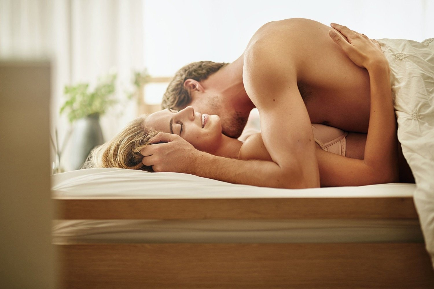 She loves it when he nuzzles her neck Shot of a young couple sharing an intimate moment in bed