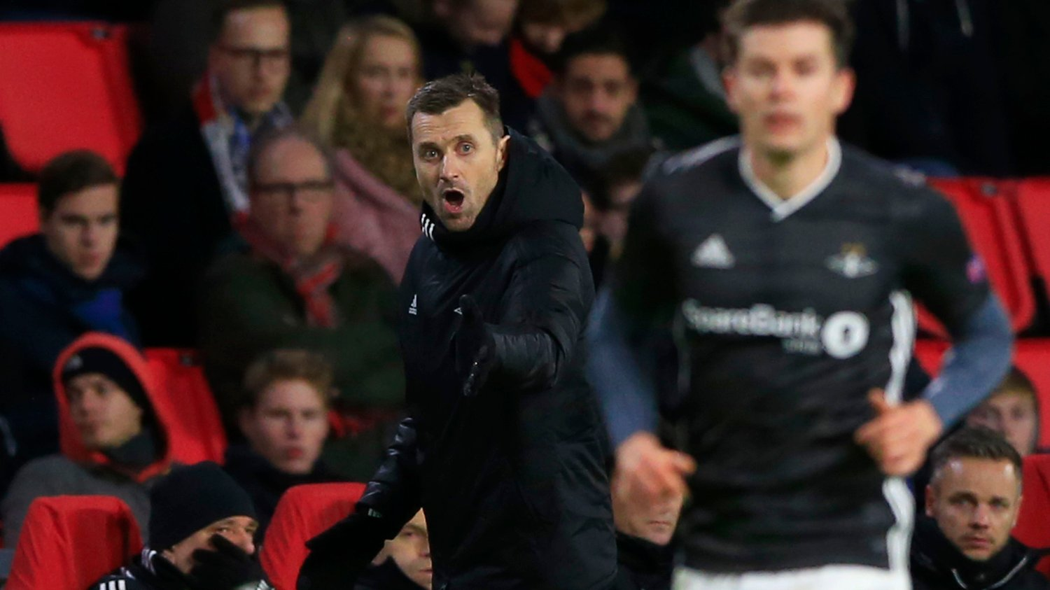 Rosenborg's head coach Eirik Horneland shouts directions to his team during the group D Europa League soccer match between PSV and Rosenborg at the Philips stadium in Eindhoven, Netherlands, Thursday, Dec. 12, 2019.