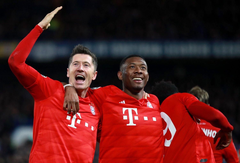 Bayern Munich's Robert Lewandowski celebrates scoring his side's third goal of the game with team mate David Alaba during the UEFA Champions League round of 16 first leg match at Stamford Bridge, London.