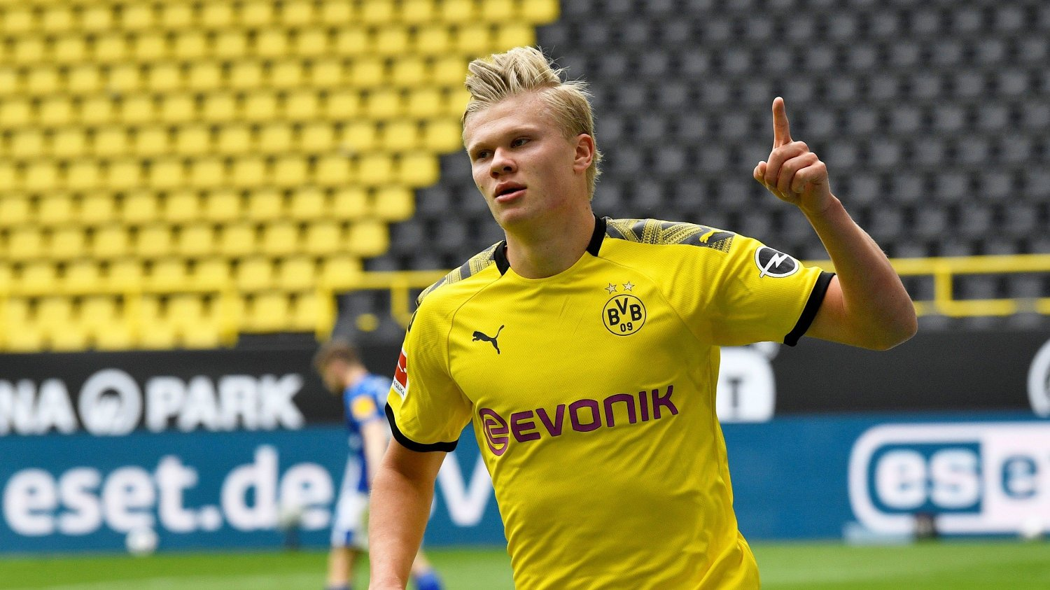 Soccer Football - Bundesliga - Borussia Dortmund v Schalke 04 - Signal Iduna Park, Dortmund, Germany - May 16, 2020 Dortmund's Erling Braut Haaland celebrates scoring their first goal as play resumes behind closed doors following the outbreak of the coronavirus disease Martin Meissner/Pool via REUTERS DFL regulations prohibit any use of photographs as image sequences and/or quasi-video