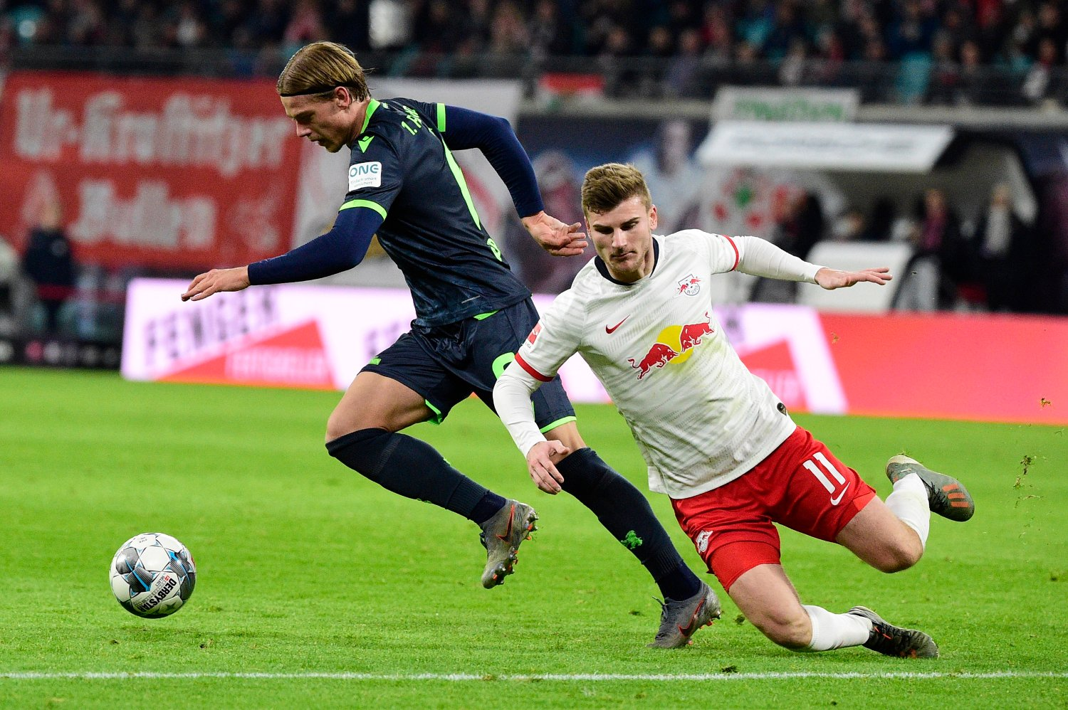 Leipzig's Timo Werner, right, and Union's Julian Ryerson vie for the ball during the German Bundesliga soccer match between RB Leipzig and Union Berlin in Leipzig, Germany, Saturday, Jan. 18, 2020.