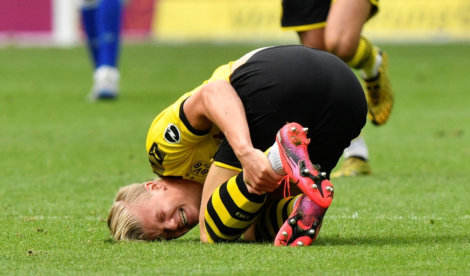 Soccer Football - Bundesliga - Borussia Dortmund v Schalke 04 - Signal Iduna Park, Dortmund, Germany - May 16, 2020 Dortmund's Erling Braut Haaland down injured, as play resumes behind closed doors following the outbreak of the coronavirus disease Martin Meissner/Pool via REUTERS DFL regulations prohibit any use of photographs as image sequences and/or quasi-video