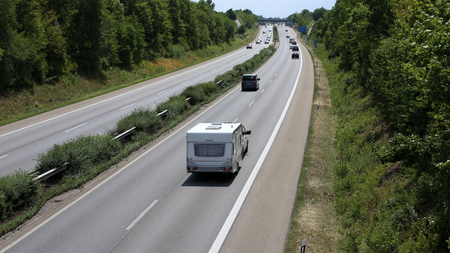 Car towing caravan on european motorway Car towing caravan on european motorway
