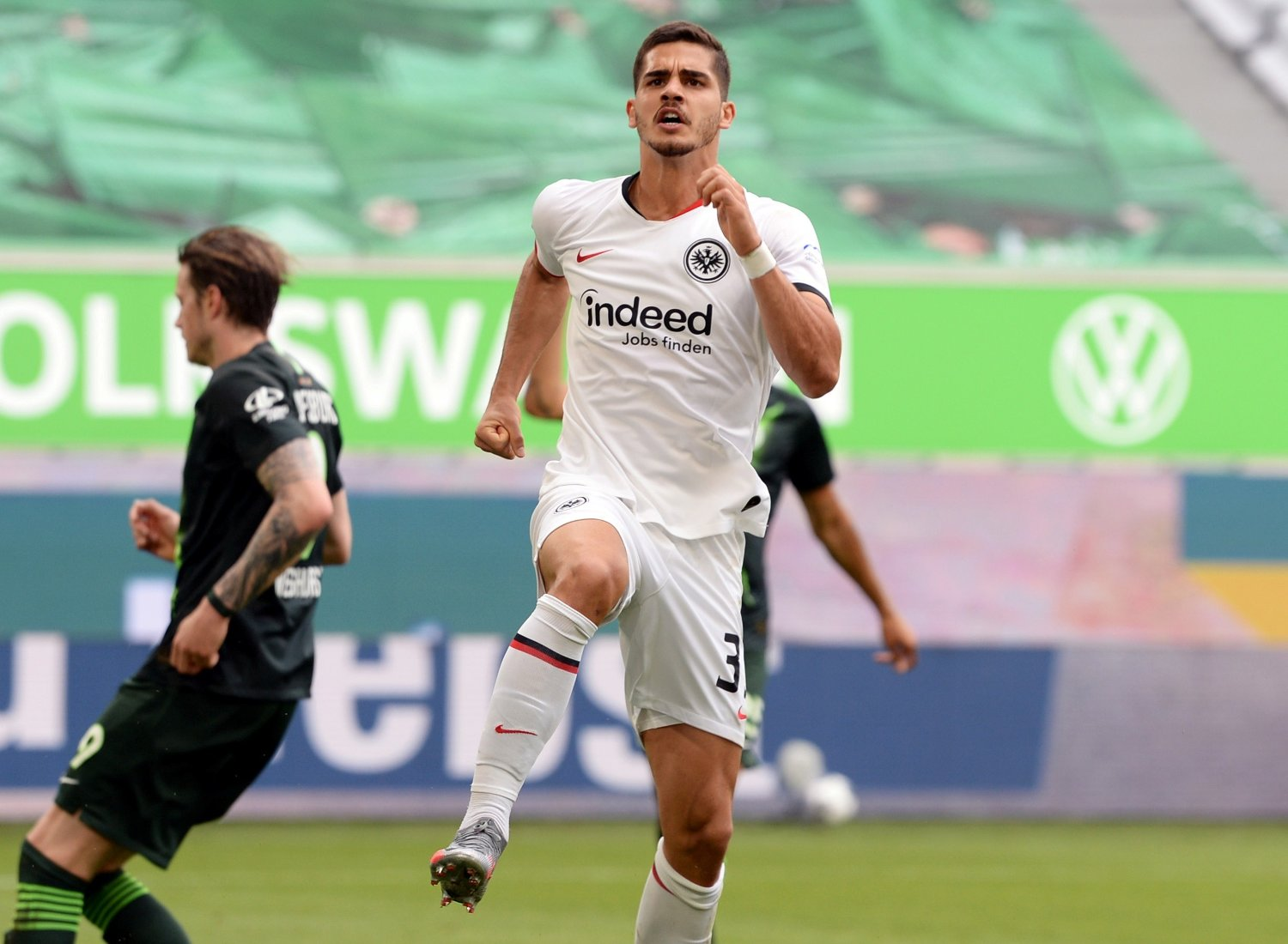 Soccer Football - Bundesliga - VfL Wolfsburg v Eintracht Frankfurt - Volkswagen Arena, Wolfsburg, Germany - May 30, 2020 Eintracht Frankfurt's Andre Silva celebrates scoring their first goal, as play resumes behind closed doors following the outbreak of the coronavirus disease Swen Pfortner/Pool via REUTERS DFL regulations prohibit any use of photographs as image sequences and/or quasi-video