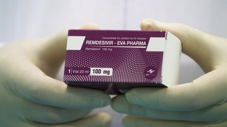 A lab technicians holds the coronavirus disease treatment drug